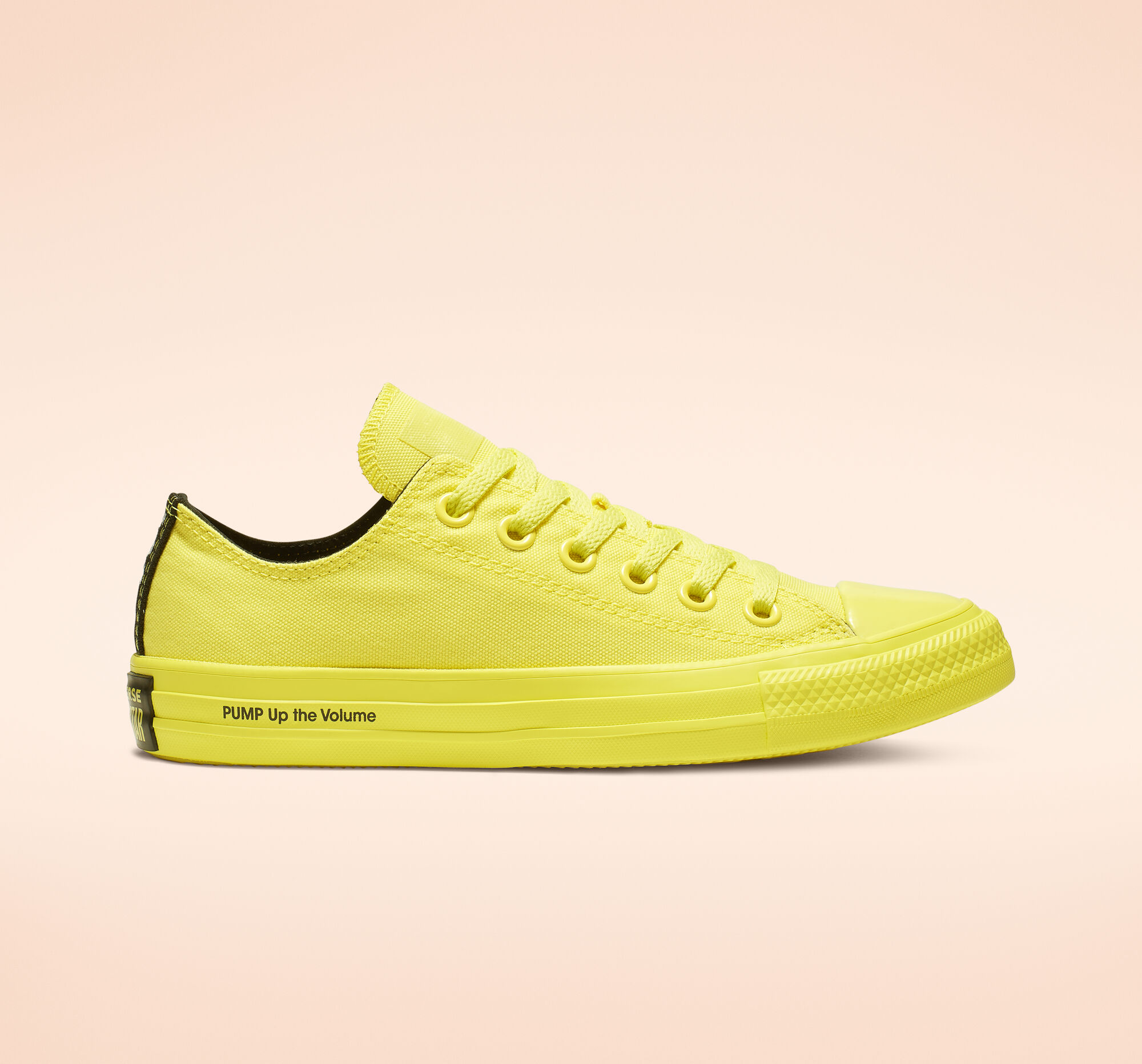 "5eb714253 All yellow with yellow laces and ""PUMP Up the Volume"" on the sole of the  shoes, these are a clean addition to any street style."